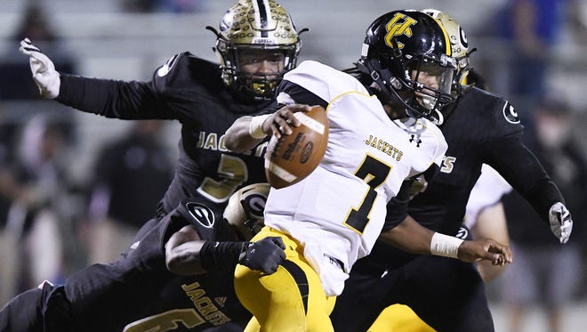 Union County (in white) and Greer compete in football during the 2017 season. The schools could be region rivals again in 2018 but only after a domino effect that would shake the membership of the South Carolina High School League.