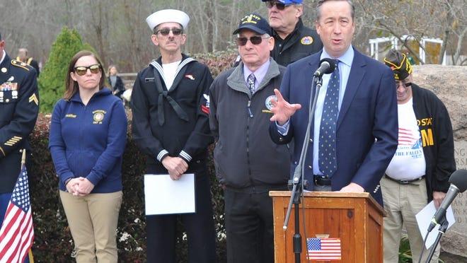 Former Marshfield selectman Joe Kelleher addresses the Marshfield Veterans Day ceremony at Veterans Memorial Park on Monday, Nov. 11, 2019.