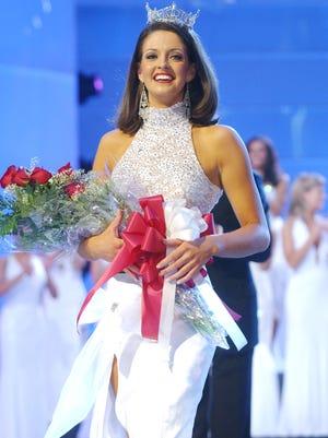 Miss America 2005 Deidre Downs, of Alabama, walks down the runway after being crowned at Boardwalk hall in Atlantic City, N.J.