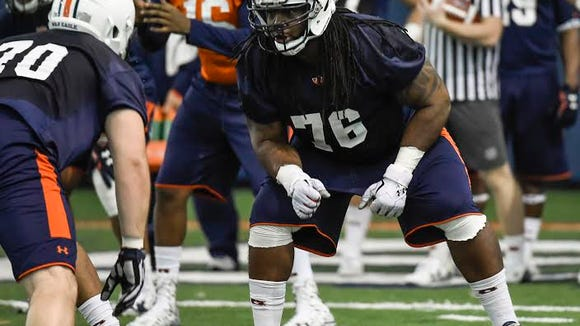 Auburn offensive lineman Jordan Diamond (76), shown here during a spring practice  on March 3, 2016, has announced his intention to not return to the Auburn program this fall.