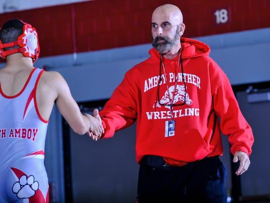 Perth Amboy wrestling head coach Mike Giordano congratulates