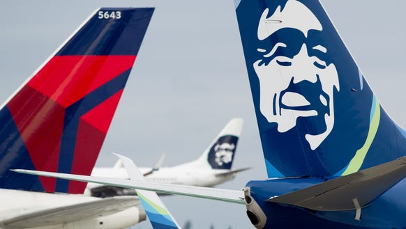 Alaska and Delta airplane tails are seen at Seattle-Tacoma