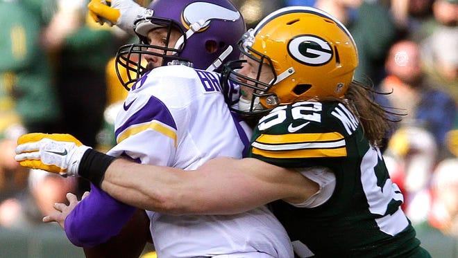Green Bay Packers outside linebacker Clay Matthews (52) sacks Minnesota Vikings quarterback Sam Bradford (8) last December.