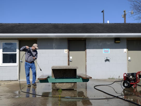 Volunteer Earl Lehman, from Bremen, power washes a