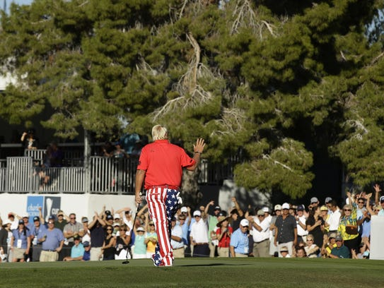 John Daly reacts after making his eagle putt on the