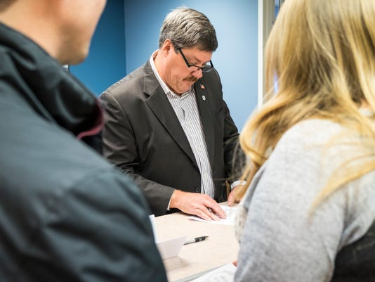 Port Huron Township supervisor Bob Lewandowski signs a marriage license before a ceremony at the township hall Nov. 22. Officials thought the supervisor could officiate the marriage under a new state law, but the legislation was never approved.