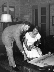 Pearl McManus looking over architectural renderings for J.W. Robinson Department Store Building, circa 1957.