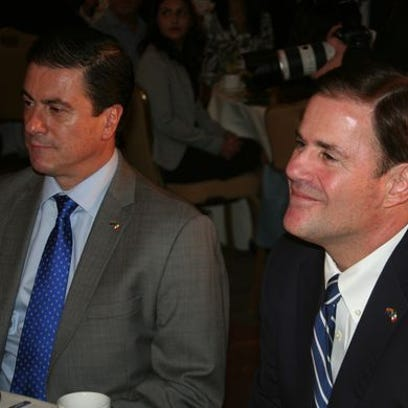 Arizona Gov. Doug Ducey (right) sits with Mexican Ambassador