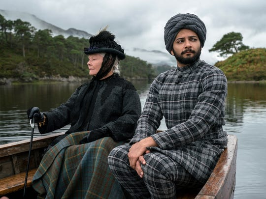 "In this image released by Focus Features, Judi Dench, left, and Ali Fazal appear in a scene from ""Victoria and Abdul."" (Peter Mountain/Focus Features via AP)"
