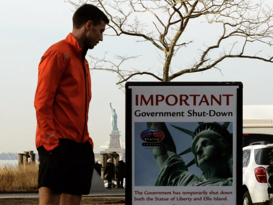 A man reads the shutdown alert at the Liberty State