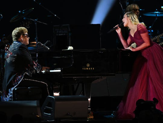 Elton John and Miley Cyrus perform ÒTiny DancerÓ during