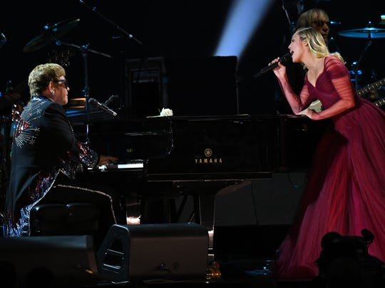 Elton John and Miley Cyrus perform ÒTiny DancerÓ during