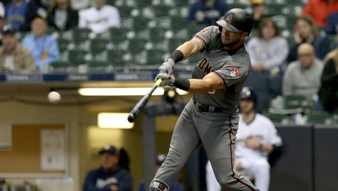 Outfielder David Peralta hits a single in the first inning on Monday. This was one of only three Diamondbacks hits.