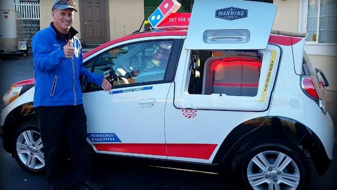Ray Sellers with the new DXP delivery vehicle for Domino's in Staunton.