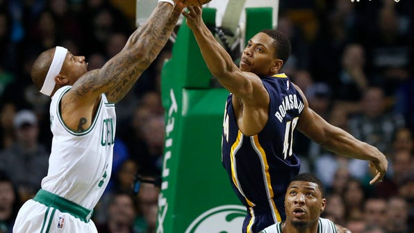 Indiana Pacers' Glenn Robinson III (40) and Boston Celtics' Isaiah Thomas, left, reach for a rebound during the second quarter of an NBA basketball game in Boston, Wednesday, March 22, 2017. (AP Photo/Michael Dwyer)