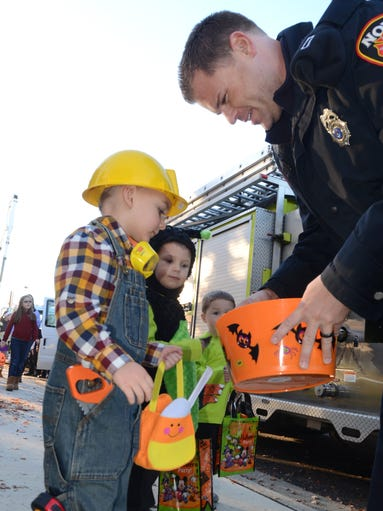 Christopher Nicolussi, 3, gets a candy treat from the