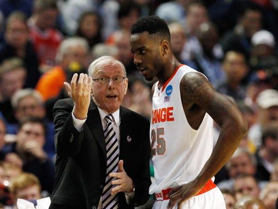 Syracuse Orange head coach Jim Boeheim talks to forward