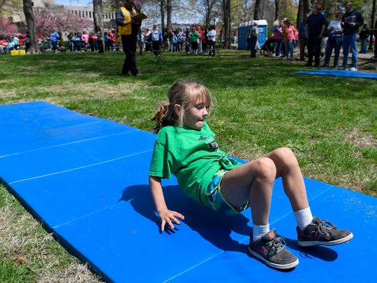 Cairo Elementary School student Kierstin Blosser, 6 years-old, starts out with the crab walk as she participates in the Girls Elementary School Relay race at the 31st annual Henderson Breakfast Lions Club Tri-Fest Saturday, April 21, 2018.