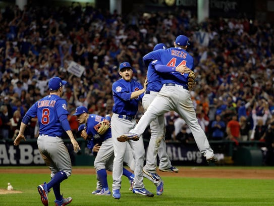 The Chicago Cubs celebrate after Game 7 of the Major