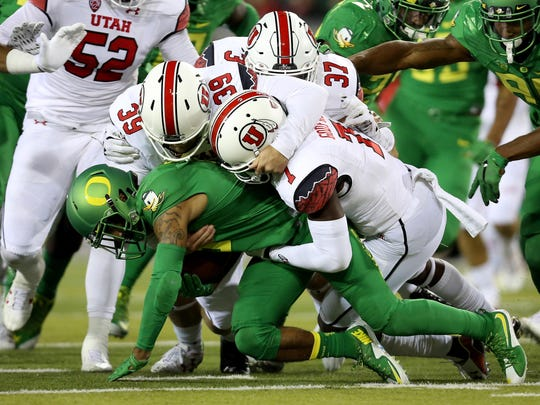FILE - In this Sept. 26, 2015, file photo, Oregon wide receiver Charles Nelson (6) is brought down by Utah defenders during the second half of an NCAA college football game, in Eugene, Ore. The Pac-12 started with six ranked teams in the AP preseason poll. No. 10 Stanford is the only one still ranked in a season of unfulfilled expectations across most of the conference. (AP Photo/Ryan Kang, File)