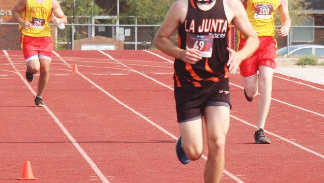 Drew Huffman of the La Junta High School cross country team heads to the finish line ahead of Rocky Ford's Nate Nealander (left) and Addison Brusuelas. Rocky Ford won both team championships.