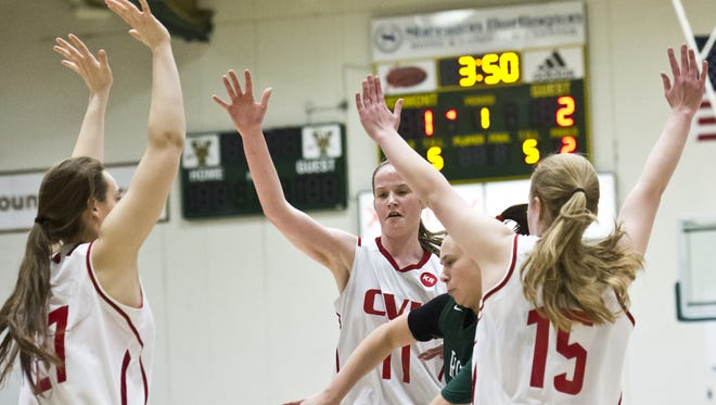 Rice's Lisa Sulejmani is nearly trapped by a CVU full court press during their semifinal girl's basketball match up Saturday, February 28, 2015, at Patrick Gym.