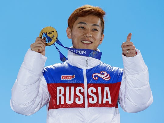 FILE - In this Feb. 15, 2014, file photo, men's 1,000-meter short track speedskating gold medalist Viktor Ahn, of Russia, gestures while holding his medal during the medals ceremony at the Winter Olympics in Sochi, Russia. Ahn returns to skate in his birth country at the Olympics after competing as a Russian in the 2016 Sochi Olympics. His nationality has taken twists and turns. He won his first four Olympic medals for South Korea in the 2006 Turin Games when he was known as Ahn-Hyun Soo. After a dispute with South Korea's short track powers, Ahn switched his nationality to Russia and won three golds in Sochi. (AP Photo/David J. Phillip, File)