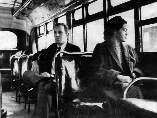 An undated photo shows Rosa Parks riding on the Montgomery