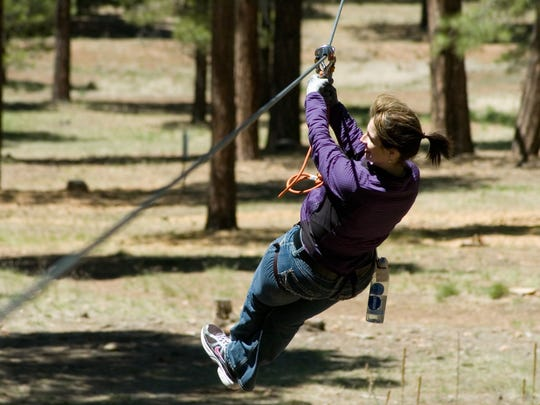 Zip lines on the Flagstaff Extreme Adventure Course provide a break from challenging obstacles.