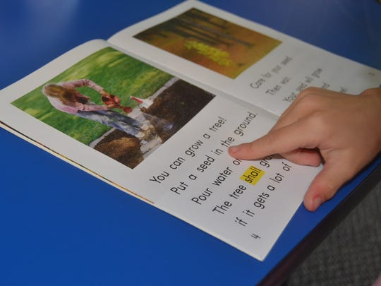 Students at the Hendersonville's SMORE Reading Camp are encouraged to follow the words with their fingers while reading.
