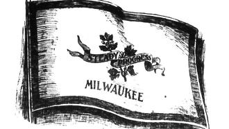 """In 1898, John Amberg's design won first place in The Milwaukee Journal's competition for a new civic flag for Milwaukee. This black-and-white rendering was published in the Jan. 10, 1898, Journal. The design includes small branch of an oak tree with a few clustering acorns on it, """"an emblem of slow but steady and sturdy growth from small beginnings,"""" along with the words """"Steady Progress"""" in black letters on a red banner and the word """"Milwaukee,"""" all on a cream background, with a blue border."""