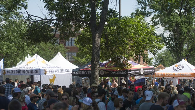 Beer fans line up to sample their favorite brews during the Colorado Brewers' Festival in Washington Park on Saturday, June 24, 2017.