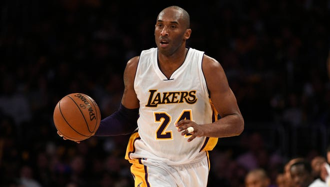 Los Angeles Lakers forward Kobe Bryant (24) brings the ball up the court during the third quarter against the New York Knicks at Staples Center. The New York Knicks won 90-87.