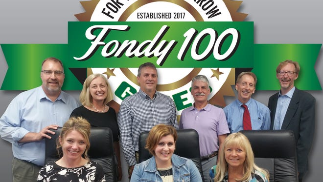 Fondy 100 Gives will bring together 100 community members to create a collective impact in Fond du Lac through contributing to projects and a future endowment fund. Pictured is the Fondy 100 Gives Steering Committee, front row, from left: Holly Brenner, Larissa Clinard and Sandi Roehrig;back row: Greg Giles, Loree Shady, Joe Braun, Phil Shepherd, Dave Hornung and Jon Mark Bolthouse. Logo designed by Dave Hornung; not pictured: Andrea Welsch, Dan Hebel and Paul Osterholm