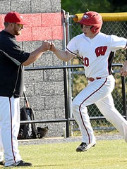 Westmoreland High head coach Will Troutt congratulates senior Tyler McLoughlin following his first-inning home run.