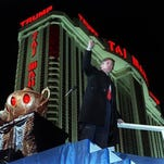 FILE - In this April 5, 1990, file photo, Donald Trump ascends the stairs with his fist raised from the genie's lamp after opening the Trump Taj Mahal Casino Resort in a spectacular show of fireworks and laser lights in Atlantic City, N.J. To his supporters, Trump's business career shows hes got the decisiveness and smarts to lead the country. To critics, his exaggerated claims, burned customers and four bankruptcies suggest a man wholly disqualified for the office.
