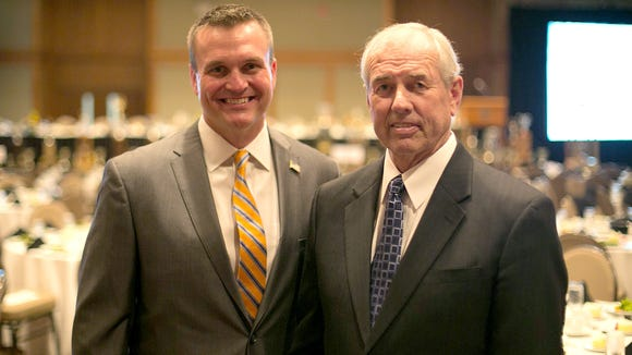 Former Roberson football coach Mike Houston, left, and ex-UNC Asheville basketball coach Eddie Biedenbach socialize during a 2014 function at the Grove Park Inn.