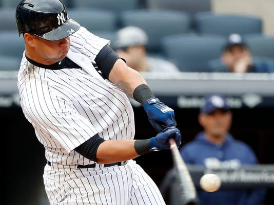 New York Yankees' Gary Sanchez connects for two-run home run off Tampa Bay Rays starting pitcher Blake Snell in the third inning of a baseball game at Yankee Stadium in New York, Wednesday, April 4, 2018. (AP Photo/Kathy Willens)