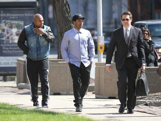 Mendeecees Harris, center, walks into federal court with his attorney Donald Thompson, right, and a companion in this April 2015 photo.