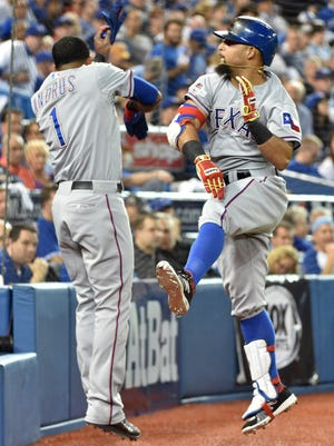 Rougned Odor (right) celebrates with shortstop Elvis Andrus (1) after hitting a solo home run.
