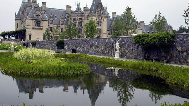In this July 6, 2005 photo, the Biltmore House is reflected in a pond on the estate in Asheville.