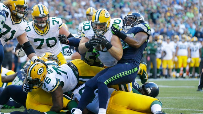 Packers fullback John Kuhn(30) dives in for a touchdown against the Seahawks.