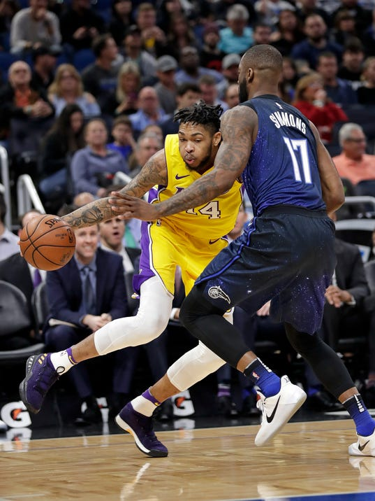 Los Angeles Lakers' Brandon Ingram, left, attempts to drive around Orlando Magic's Jonathon Simmons (17) during the first half of an NBA basketball game, Wednesday, Jan. 31, 2018, in Orlando, Fla. (AP Photo/John Raoux)
