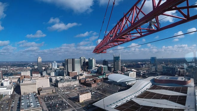 A view from the cabin of a crane operator as he works on the Westin Nashville Hotel.