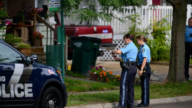 Lansing Police work at the scene of a stabbing near the intersection of Taft and Vermont in Lansing Friday morning, Aug. 18, 2017, where two women were stabbed.  Lansing Police say one woman was taken to the hospital with non-life threatening injuries. The incident is under investigation.  [MATTHEW DAE SMITH/Lansing State Journal]