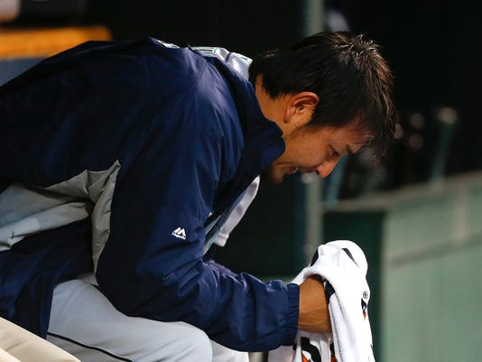 Seattle Mariners pitcher Hisashi Iwakuma sits on the bench after being relieved during the fifth inning of the team's baseball game against the Detroit Tigers in Detroit, Wednesday, June 22, 2016. (AP Photo/Paul Sancya)