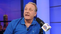 Curt Schilling talks during a commercial break in his