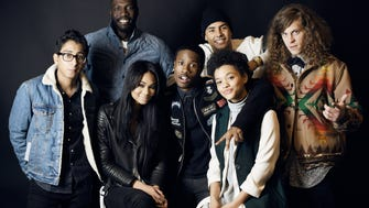 """PARK CITY, UT - JANUARY 24:  (L-R) Actor Tony Revolori, director/writer Rick Famuyiwa, actors Chanel Iman, Shameik Moore, Quincy Brown, Kiersey Clemons and Blake Anderson from """"Dope"""" pose for a portrait at Sundance Film Festival on January 24, 2015 in Park City, Utah.  (Photo by Jeff Vespa/WireImage)"""