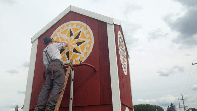 A demonstration of how to make barn stars — also known as hex signs — was featured at the Kutztown Folk Festival.