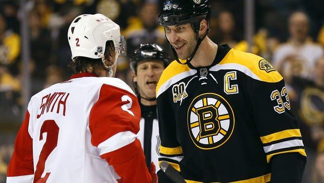 Boston Bruins' Zdeno Chara stares at Detroit Red Wings' Brendan Smith during the first period of Game 2 of a first-round NHL hockey playoff series in Boston Sunday, April 20, 2014.